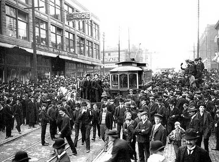 Seattle, March 1903. Crowd surrounding streetcar during strike against Seattle Electric Co., in front of Bon Marche, 2nd Ave. and Pike St.